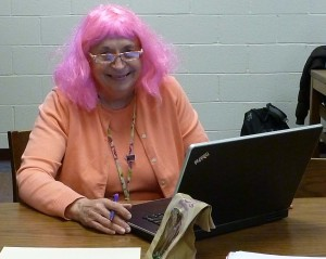Mrs. Eshbach wearing a purple wig to grant a student's wish.