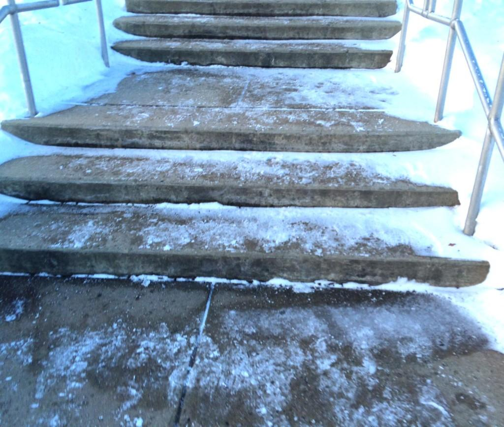 Snow covered steps at the band lot.