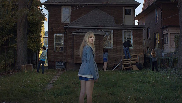 Maika Monroe being followed (or is she?) in It Follows.