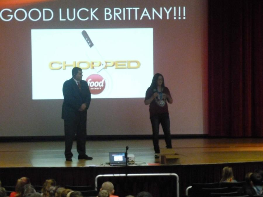 Junior+Brittany+Matteson+is+cheered+on+during+a+class+assembly.