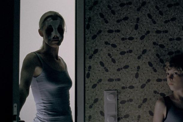 Lukas hiding from an eerie looking mother in Goodnight Mommy