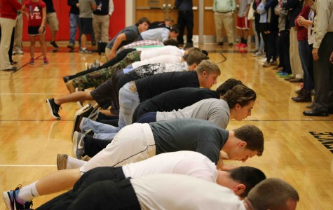 Students participate in Veterans Day pushup contest.