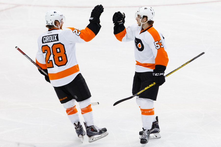 11+DEC+2015%3A+Philadelphia+Flyers+Defenceman+Shayne+Gostisbehere+%2853%29+%5B9358%5D+celebrates+his+goal+with+Center+Claude+Giroux+%2828%29+%5B5703%5D+during+the+NHL+game+between+the+Philadelphia+Flyers+and+the+Dallas+Stars+at+the+American+Airlines+Center+in+Dallas%2C+TX.++%28Photo+by+Andrew+Dieb%2FIcon+Sportswire%29