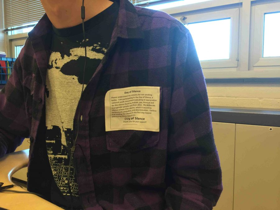 Senior James Bouffard wears a Day of Silence card in class to bring attention to unfairness, specifically toward the LGBT community.