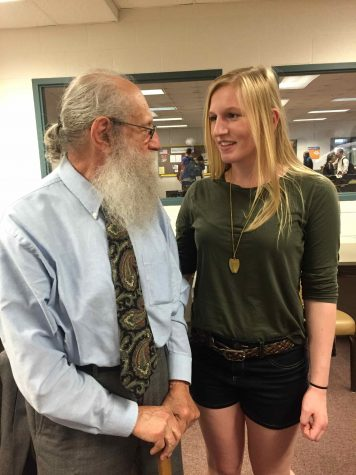 Junior Lauren Moyer talks with Holocaust survivor Joseph Hirt during one of his breakout sessions with students.