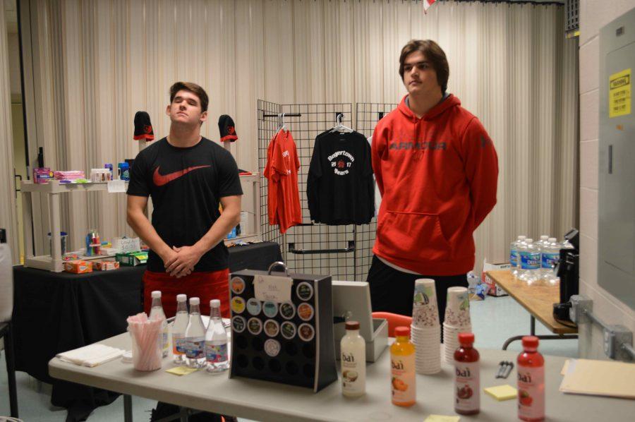 School Store Employees Seniors Ryan Zern and Dino Charitos at work.