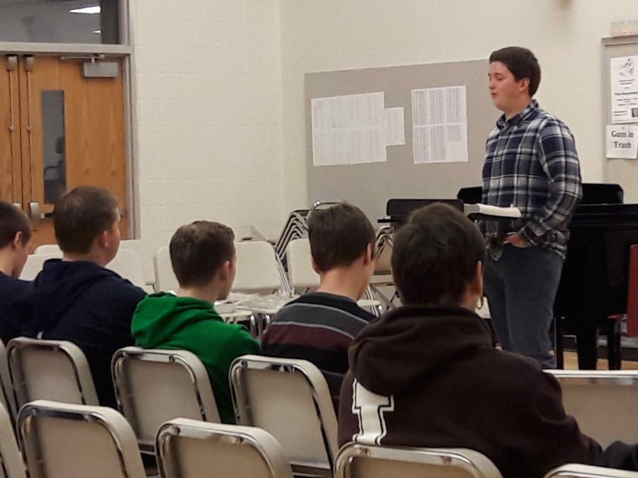 Senior Kyle Grater teaches a Bible lesson to the FCA group at one of the Tuesday morning meetings.