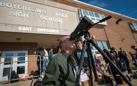 Mr. Detterline teaches students how to use different kinds of telescopes so they can look into space