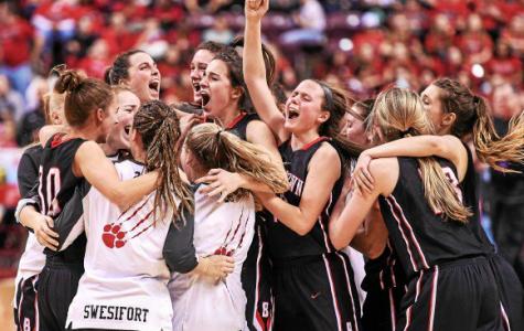 Girls Basketball celebrates its state championship win.