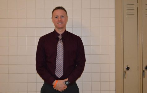 New English Teacher Strives to Motivate Students in Class, on the Field