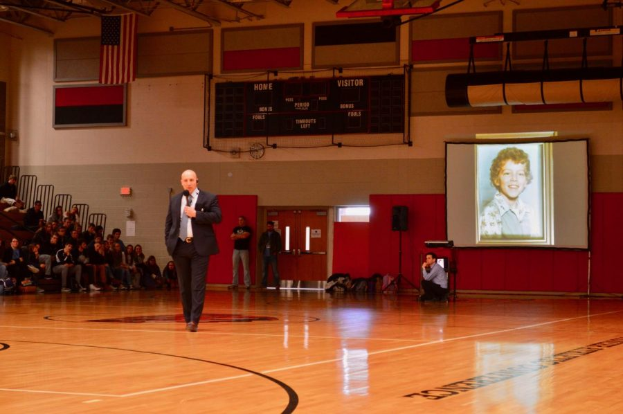 Dr. Cooper speaks at the 2018 Mini-THON Kickoff Pep Rally about his brother, who died from cancer.