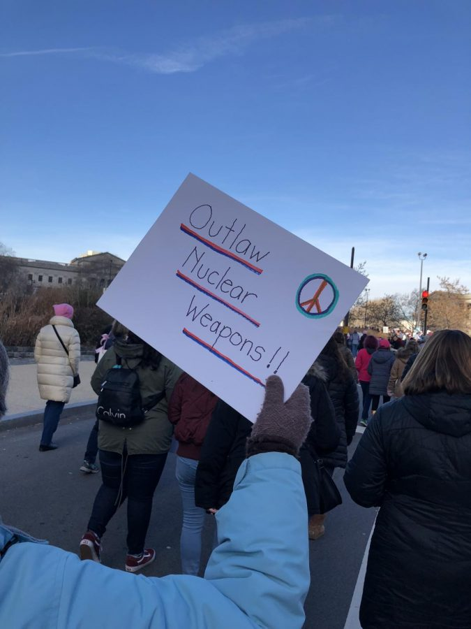 Woman hold sign that reads