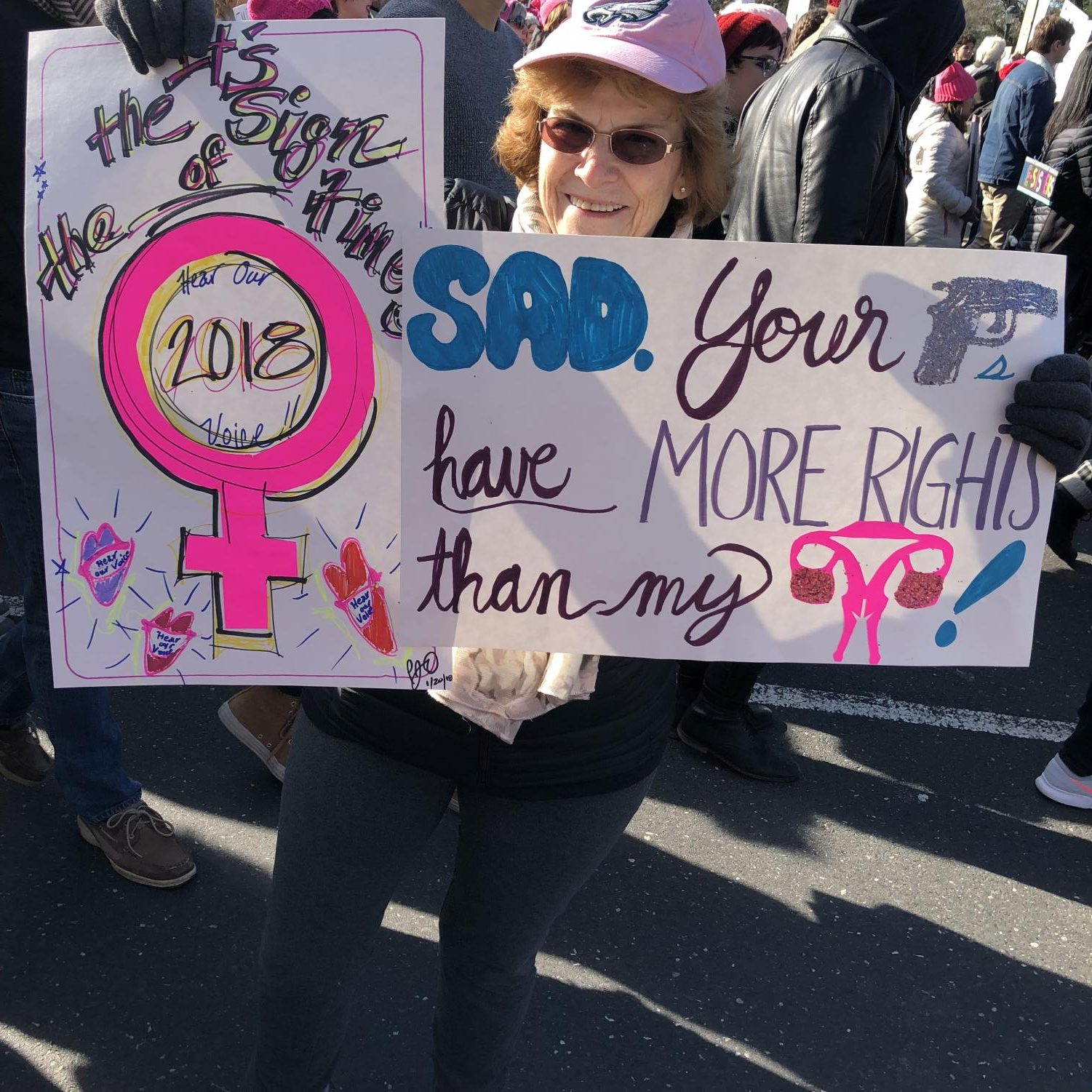 older woman with poster