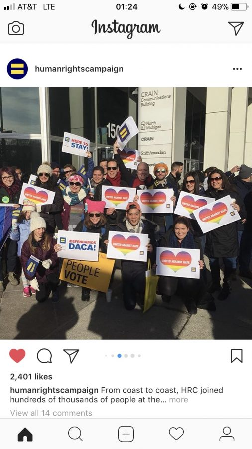 Human rights campaigners post together at a march in Chicago