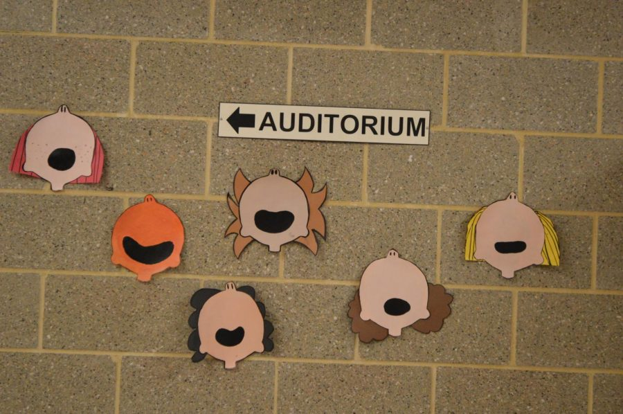 The Peanuts beckon students to come out to see the school play.