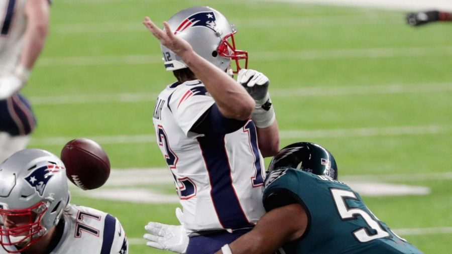 The Eagles' Brandon Graham strips the ball from Tom Brady in one of the biggest plays of Super Bowl LII.