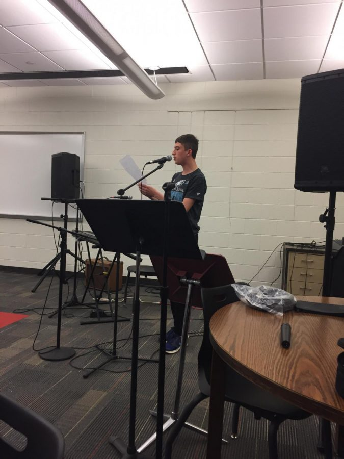 Sophomore Eric Then sings an original song at the coffeehouse.