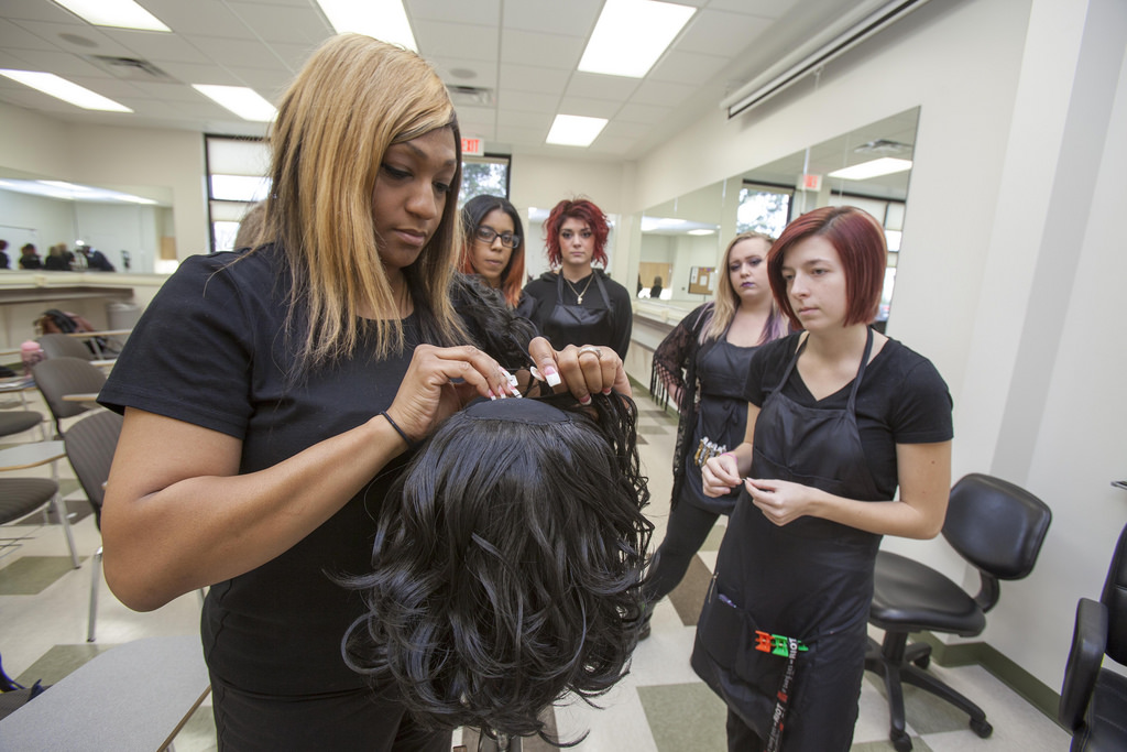 Students in the College of DuPage Cosmetology Program listen to an instructor.