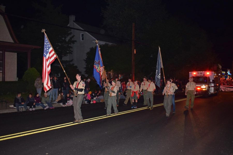 BSA Troop 523's honor guard brings up the front of the Bally Lions Halloween Parade.