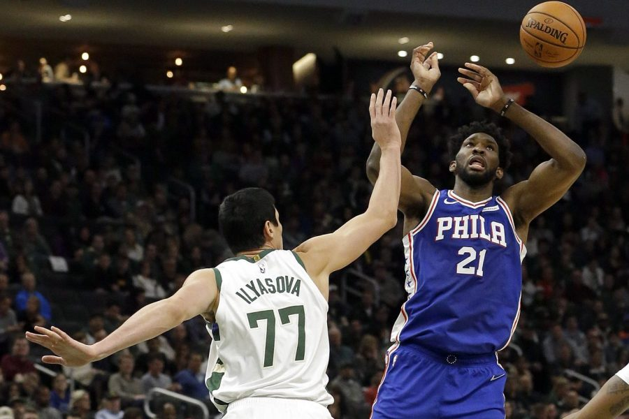 Sixers%27+Joel+Embiid+is+defended+by+former+Sixer+Ersan+Ilyasova+as+the+Milwaukee+Bucks+roll+over+the+Sixers+123-108.