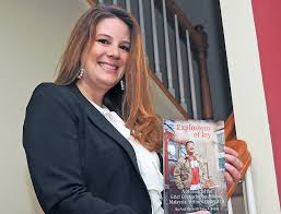English Teacher Mrs. Trina Kraus with her book