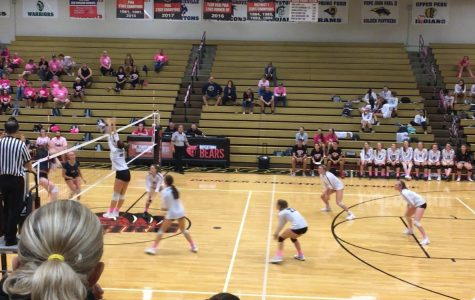 Junior Emily Wolfe makes a block against Spring Ford.