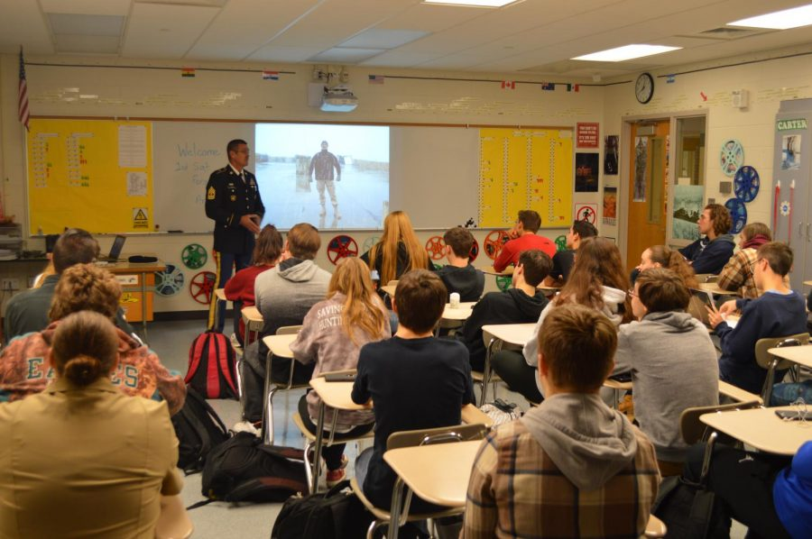 An+Army+veteran+talks+to+Global+Studies%2C+Economics+and+Government+students+as+part+of+BASH%27s+Veterans+Day+activities.+