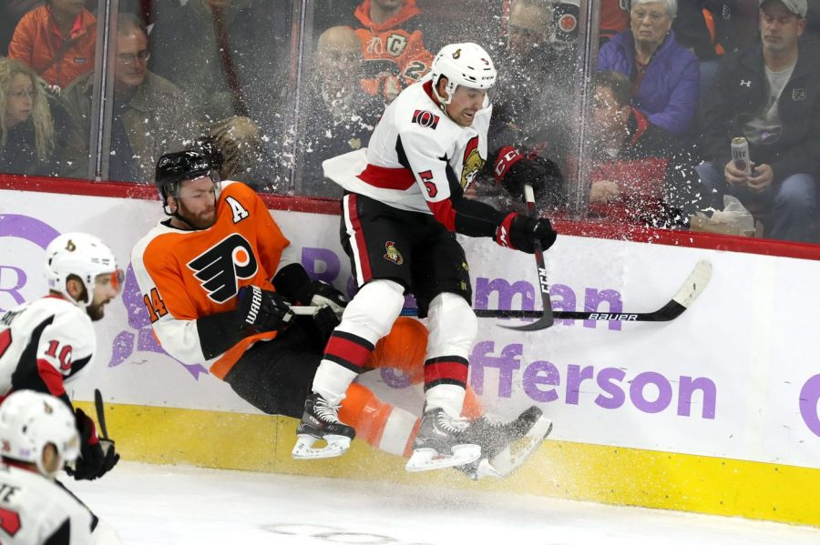 Ottawa+Senators%27+Cody+Ceci+slams+Flyers%27+Sean+Couturier+into+the+boards+as+the+Senators+defeated+the+Flyers+4-3+on+Tuesday+night.