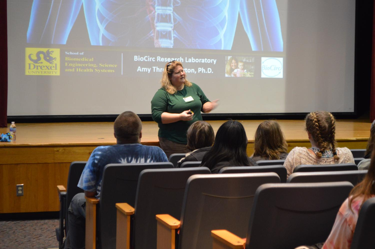 Biochemical Engineer Dr. Amy Thockmorton speaks to students.