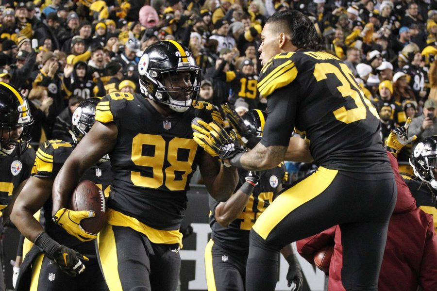 Steelers%27+Vince+Williams+%2898%29+celebrates+pick-six+off+Cam+Newton+with+James+Conner+%2830%29+in+the+1st+quarter+in+Thursday%27s+52-21+shellacking.