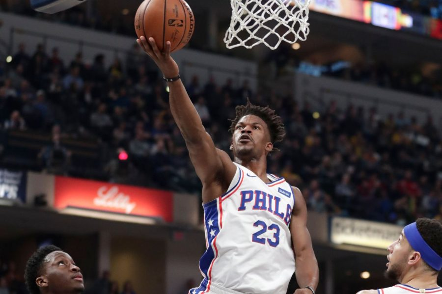 Jimmy Butler drives for a layup over Pacers' Victor Oladipo in the Sixers' 120-96 win.