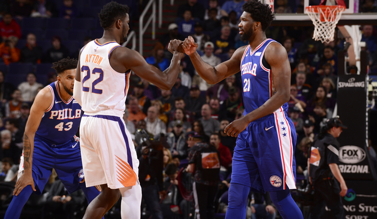 PHOENIX%2C+AZ+-+JANUARY+2%3A+Deandre+Ayton+%2322+of+the+Phoenix+Suns+and+Joel+Embiid+%2321+of+the+Philadelphia+76ers+before+the+game+on+January+2%2C+2019+at+Talking+Stick+Resort+Arena+in+Phoenix%2C+Arizona.+NOTE+TO+USER%3A+User+expressly+acknowledges+and+agrees+that%2C+by+downloading+and+or+using+this+photograph%2C+user+is+consenting+to+the+terms+and+conditions+of+the+Getty+Images+License+Agreement.+Mandatory+Copyright+Notice%3A+Copyright+2019+NBAE+%28Photo+by+Barry+Gossage%2FNBAE+via+Getty+Images%29