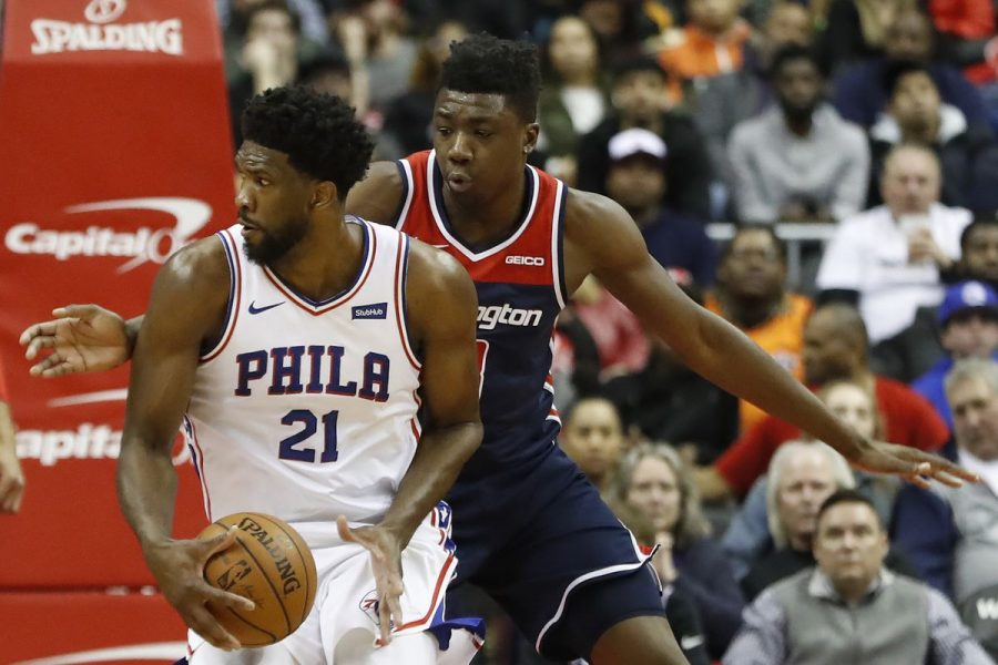 Sixers%27+Joel+Embiid+attempts+to+score+in+the+paint+in+the+loss+to+the+Wizards+on+Wednesday.