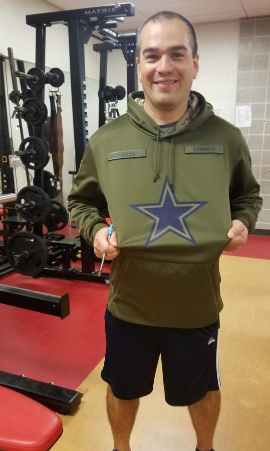 Physical+Education+Teacher+Mr.+Randall+Yenser+flaunts+his+Dallas+sweatshirt%2C+just+one+of+many+pieces+of+Cowboys+gear+he+wears+at+school.+