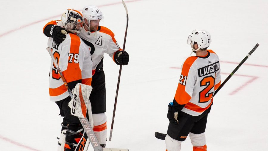 Carter+Hart%2C+Sean+Couturier%2C+and+Scott+Laughton+celebrate+back-to-back+wins+over+the+weekend+against+Detroit.