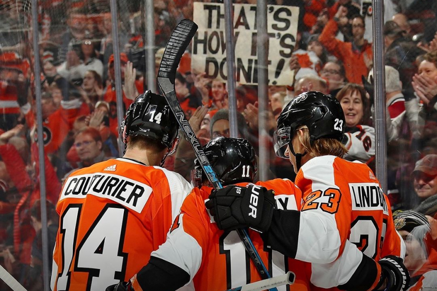 Flyers%27+Sean+Couturier%2C+Travis+Konecny%2C+and+Oskar+Lindblom+celebrate+the+Flyers%27+7th+consecutive+win.