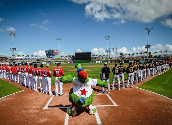 The Phillies and Pirates stand for the national anthem before the Pirates would beat the Phillies 3-2 on Saturday at Spectrum Field in Clearwater, Florida.