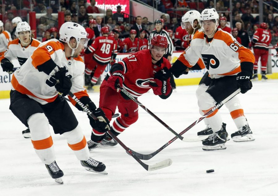 The Carolina Hurricanes defeated the Flyers 5-2 on Saturday, mathematically eliminating Philadelphia from playoff contention.