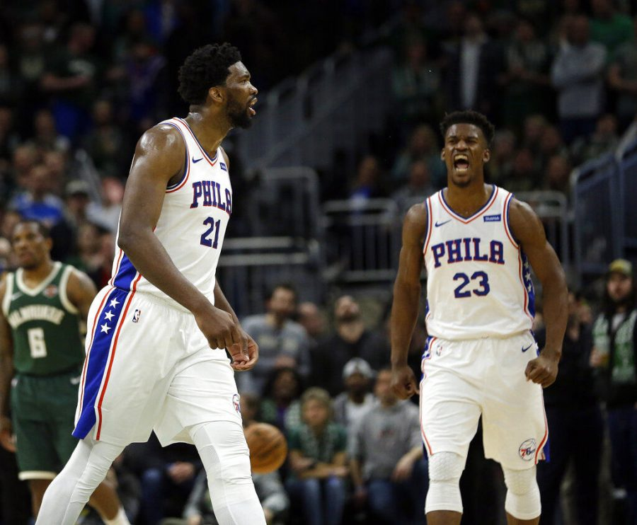 Sixers%27+Joel+Embiid+and+Jimmy+Butler+as+the+Sixers+clinched+a+playoff+berth%2C+beating+the+1st+place+Bucks+130-125.