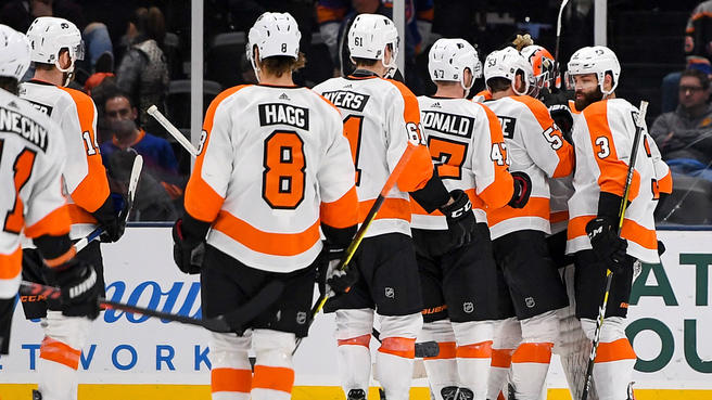 The+Flyers+celebrate+their+4-1+win+over+the+New+York+Islanders+on+Sunday+afternoon.