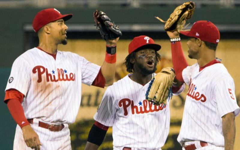 Jul 28, 2017; Philadelphia, PA, USA; Philadelphia Phillies right fielder Aaron Altherr (23) and center fielder Odubel Herrera (37) and right fielder Nick Williams (5) celebrate a victory against the Atlanta Braves at Citizens Bank Park. Mandatory Credit: Bill Streicher-USA TODAY Sports