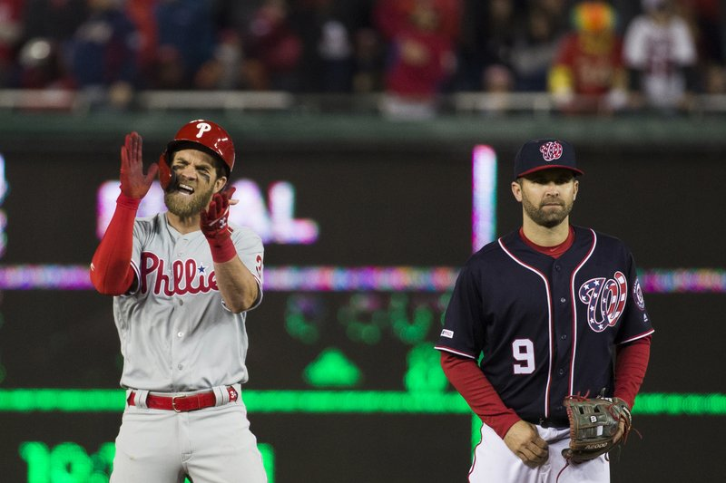 Bryce Harper celebrates an RBI double in the Phillies' 8-2 win over the Nationals on Tuesday.