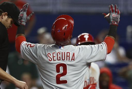 Phillies' shortstop Jean Segura crosses the plate after hitting a game-winning, 2-run home run to defeat the Miami Marlins on Sunday afternoon.