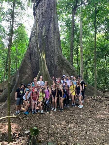 Students+pose+for+a+group+shot+in+front+a+a+tree+in+the+Arenal+Volcano+Area.
