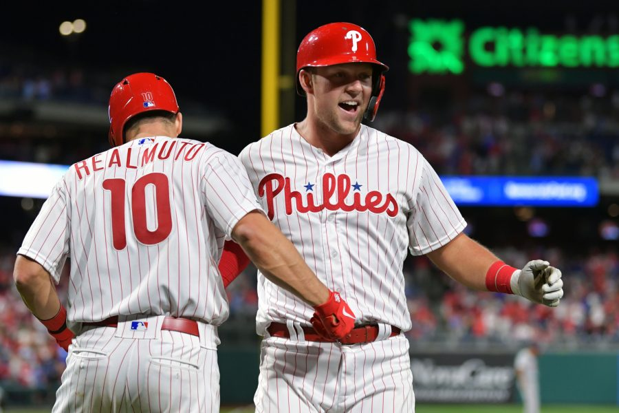 PHILADELPHIA, PA - APRIL 08: Rhys Hoskins #17 of the Philadelphia Phillies gets congratulated by teammate J.T. Realmuto #10 after hitting a home run in the eighth inning against the Washington Nationals at Citizens Bank Park on April 8, 2019 in Philadelphia, Pennsylvania. The Phillies won 4-3. (Photo by Drew Hallowell/Getty Images)