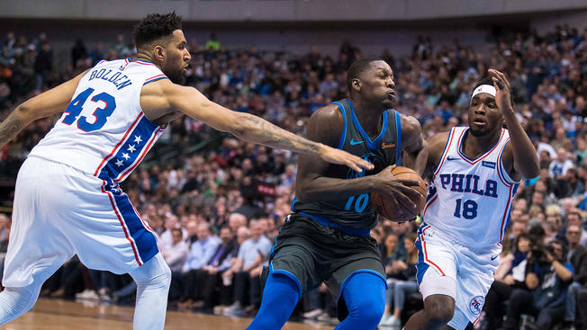 Sixers%27+Jonah+Bolden+and+Shake+Milton+attempt+to+defend+Mavericks%27+Dorian+Finney-Smith+in+a+blowout+Sixers+loss%2C+122-102.+