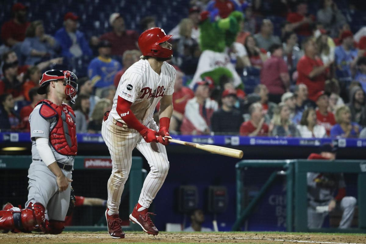 Phillies' Bryce Harper watches his 2-run  homer in the 3rd inning of the Phillies' 11-4 game 2 win on Wednesday night. He finished the night with a single, double, and homer.