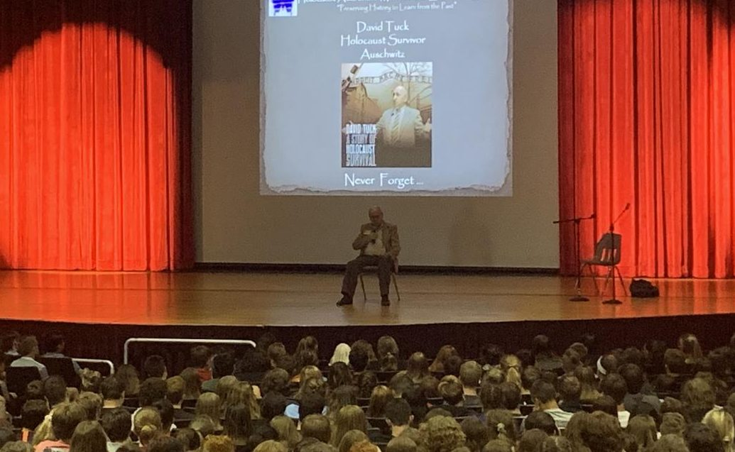 Mr. Tuck was ten years old when Germany invaded Poland. Throughout his presentation, he told his story.