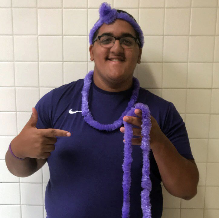 Senior Quincy Jones goes all out for CF Awareness Day by wearing purple from head to toe.
