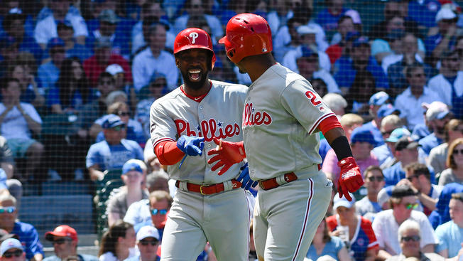 Phillies' Andrew McCutchen and Jean Segura celebrate after Segura's 2-run homer in the Phillies' 9-7 win over the Cubs on Thursday.